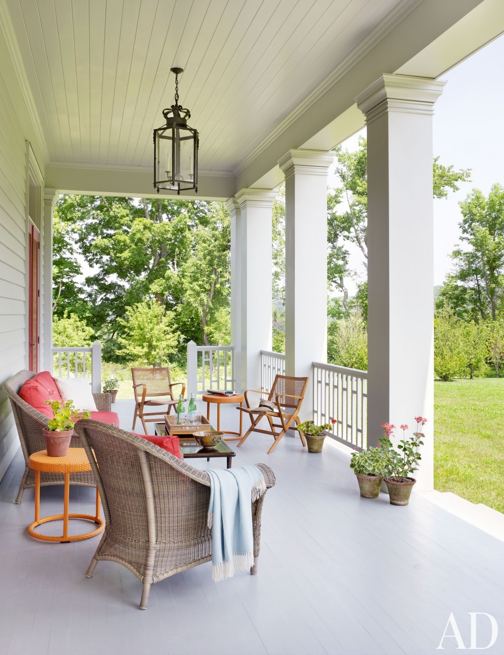 Traditional Outdoor Living by Katie Ridder and Peter Pennoyer in Millbrook, NY