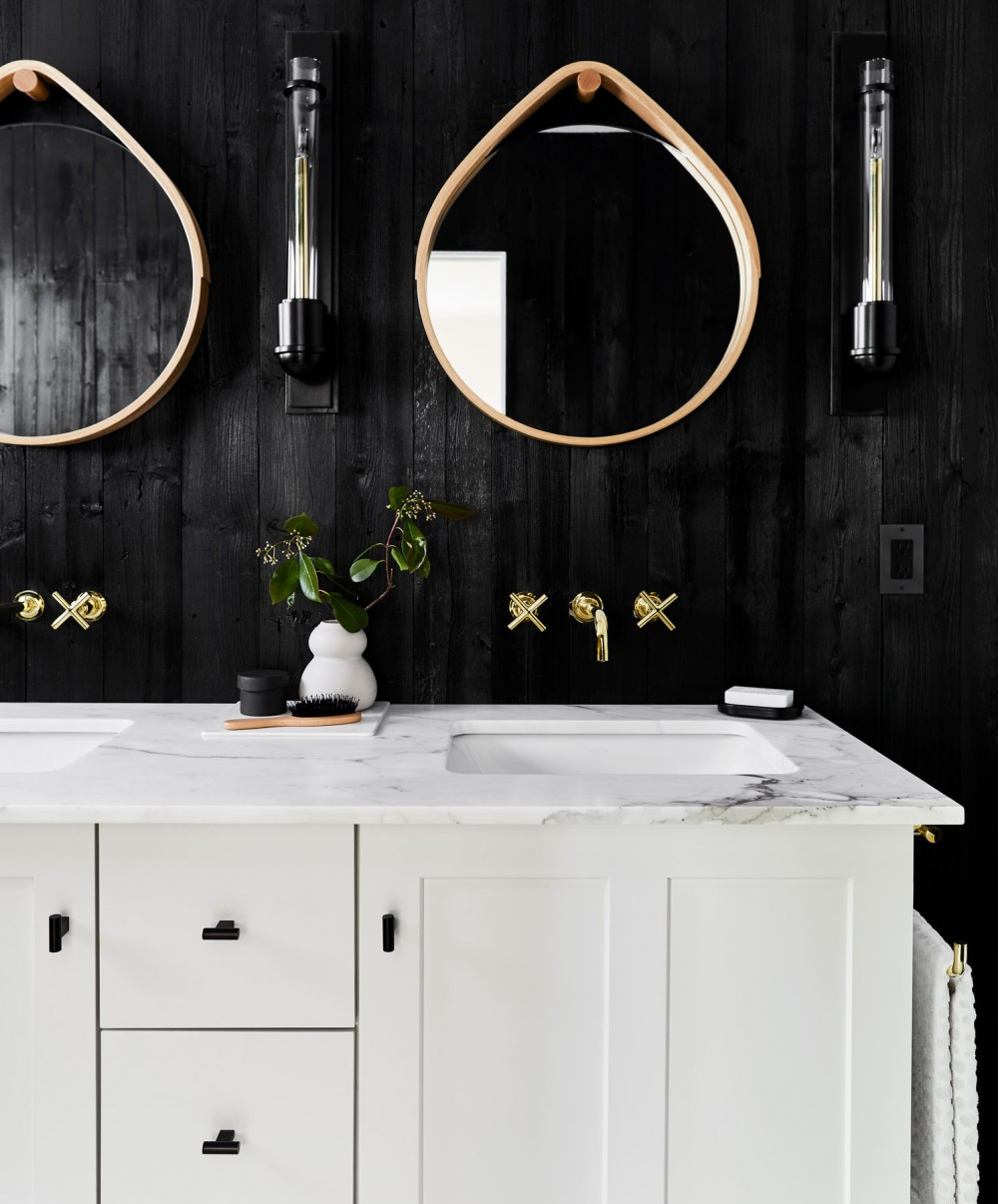 Poplin® vanity    Purist® bathroom sink faucet    Caxton® bathroom sink    Black oil-stained wood-paneled walls add a luxurious and moody dimension to this  guest bathroom.