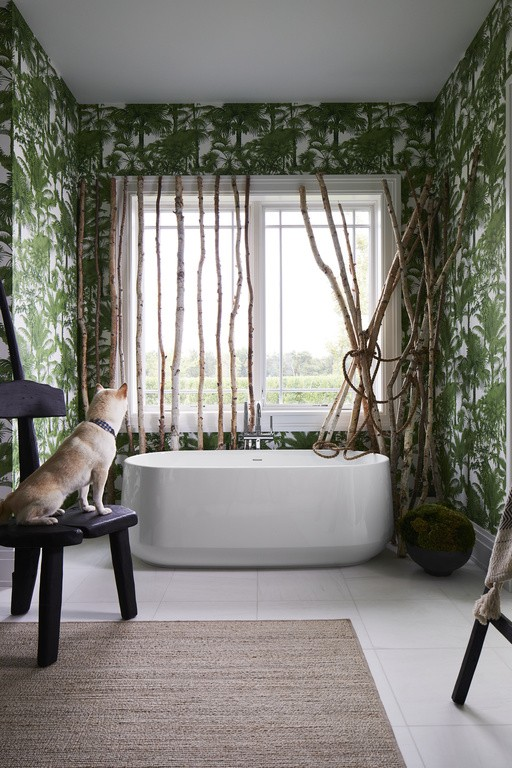 Ceric® freestanding bath    Purist® floor-mount bath filler    Surrounded by a verdant canopy, this freestanding bath offers its owners their own private rainforest retreat.
