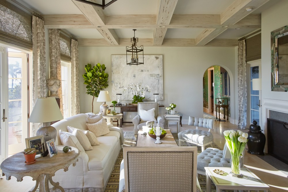 Adorned in layers of neutral tones punctuated by refreshing bursts of green, the family room offers a calming sanctuary for enjoying quality time and taking in views of the water.