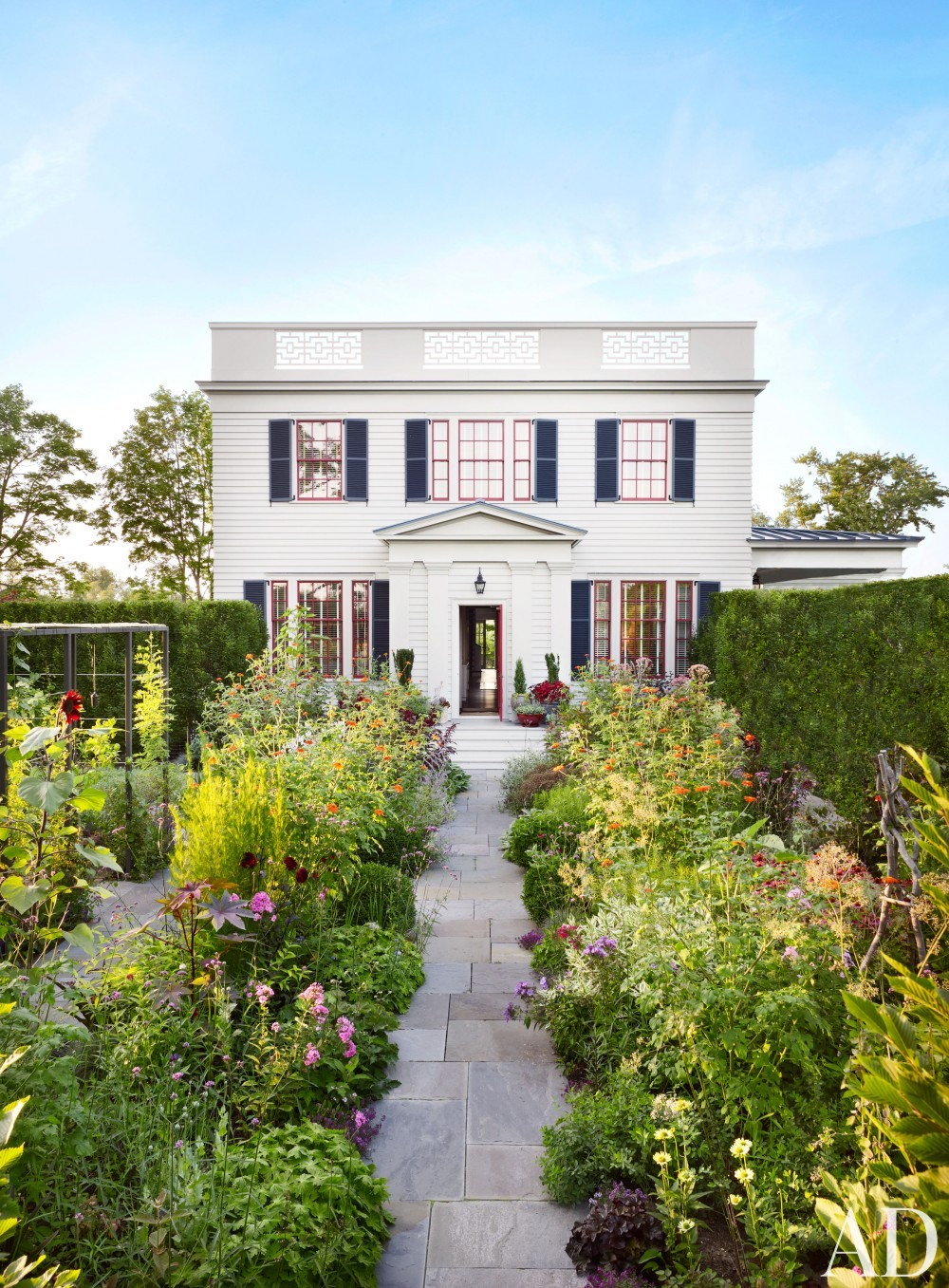 Traditional Exterior by Katie Ridder and Peter Pennoyer in Millbrook, NY