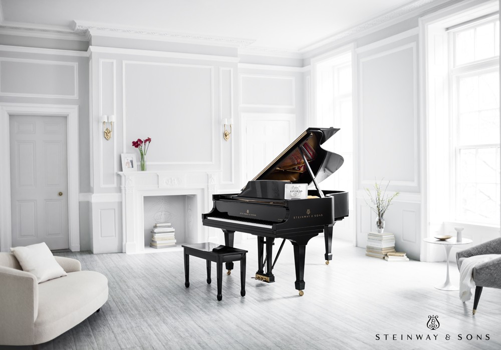 White walls and furnishings are interrupted beautifully by the new Steinway & Sons Spirio, the world\'s finest high-resolution player piano. A masterpiece of artistry and engineering, Spirio enables you to...