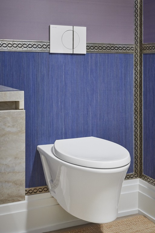 Veil® wall-hung toilet    The graceful silhouette of the wall-hung toilet complements the warm, inviting colors and textures found throughout the room.