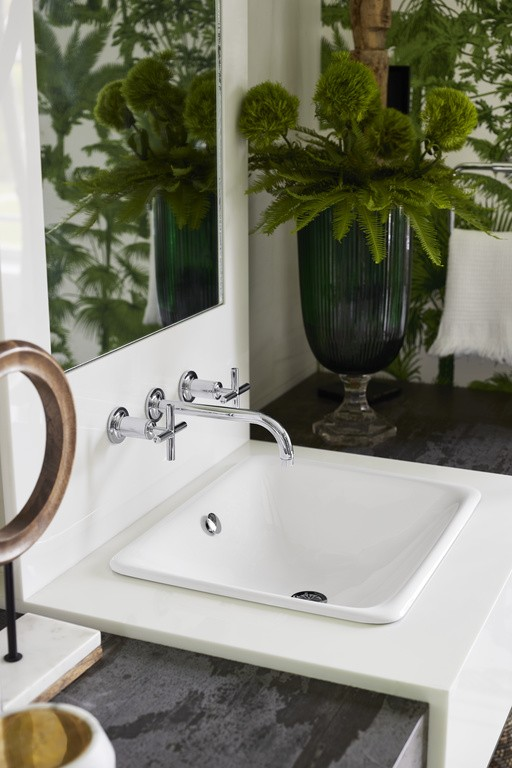 Iron Plains® bathroom sink    Purist® wall-mount bathroom sink faucet    A Polished Chrome faucet and White enameled cast iron sink help maintain order and symmetry to balance the free-form shapes and lush colors.