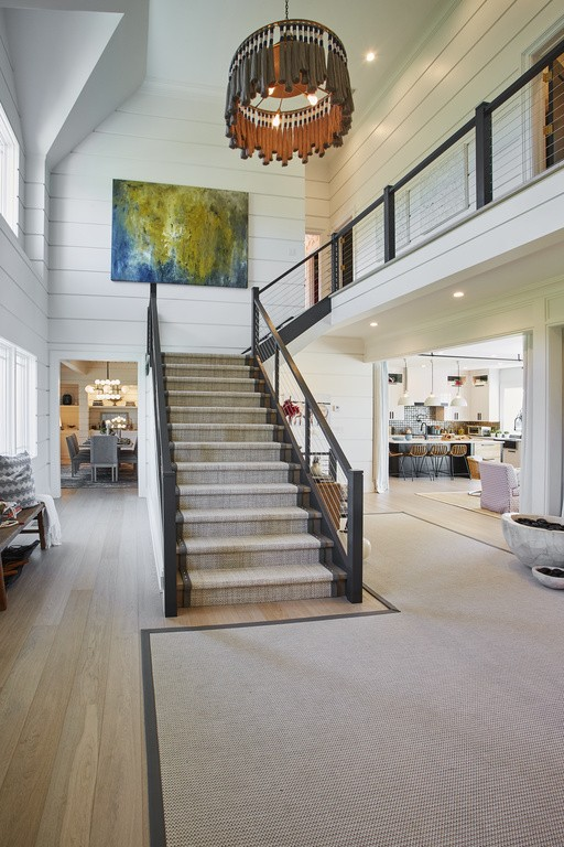 Wide wale shiplap walls lend a nautical backdrop to the soft, organic colors and casually inviting mood in the entry foyer.