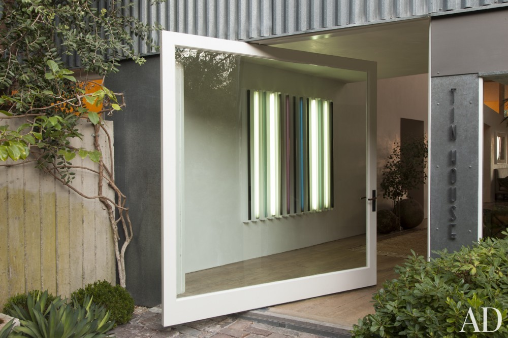 Contemporary Entrance by Estee Stanley Interior Design in Malibu, California