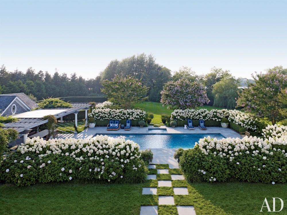 Contemporary pool by Juan Montoya Design in Southampton, NY