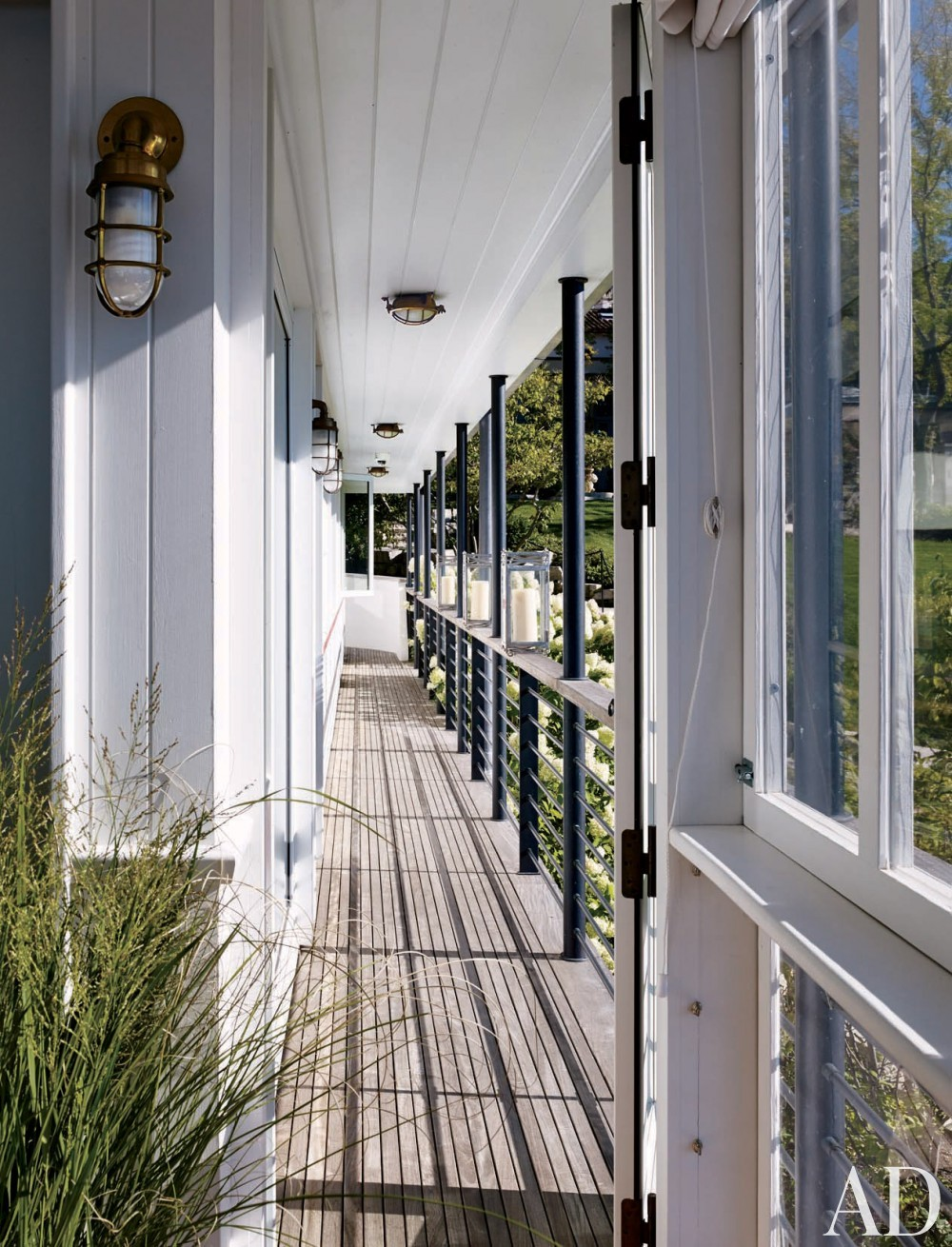 Contemporary Porch by Michael S. Smith Inc. and HBRA Architects in Geneva Lake, Wisconsin