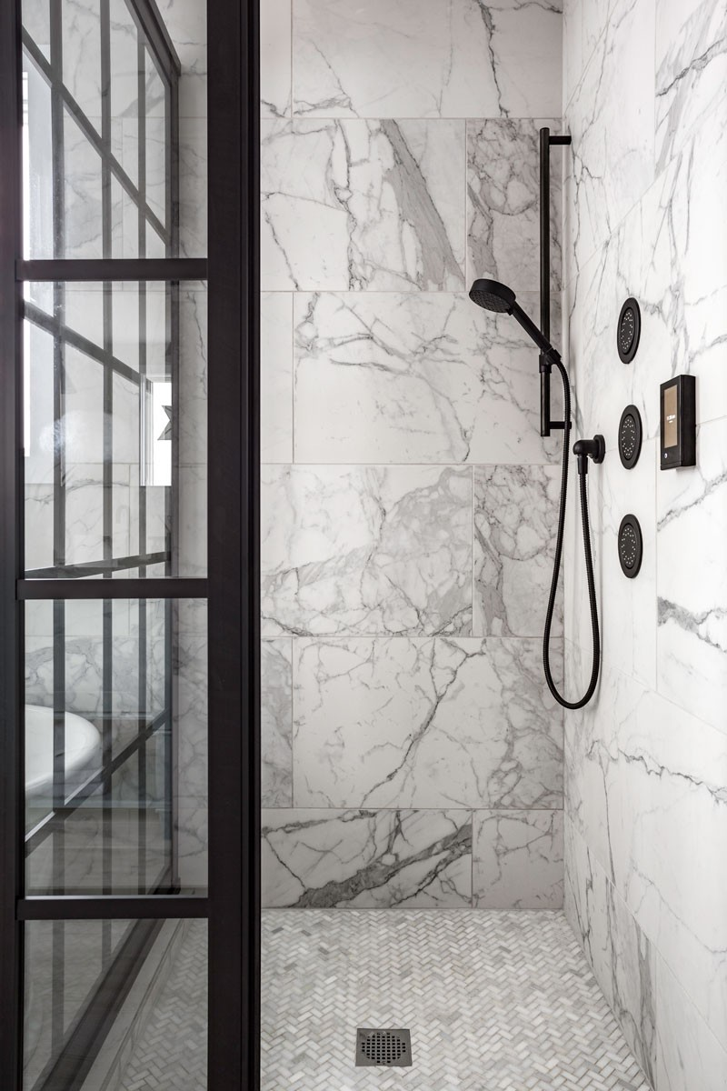 DTV+ digital interface    Watertile    Purist Handshower    A multi-paneled glass enclosure and matte black showerhead carry on the industrial chic motif from the vanity area, while digital controls provide a customized and thoroughly modern shower experience.