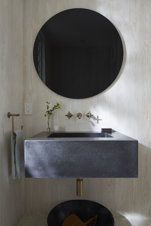 Purist® faucet    Simple geometric shapes perfectly exemplify a modern minimalist aesthetic in this powder room.