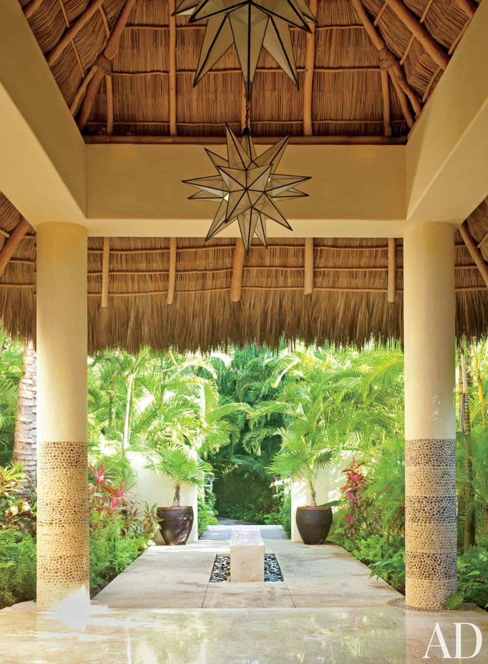Exotic Entrance Hall by Martyn Lawrence Bullard in Punta Mita, Mexico