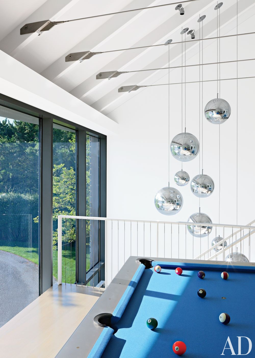 Modern Media/Game Room by KA Design Group and Leroy Street Studio in East Hampton, New York