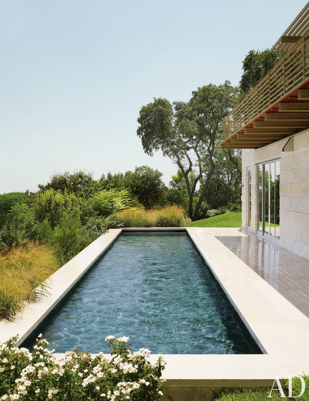 Modern Pool by Terry Hunziker Inc. and Lake | Flato Architects in Austin, Texas