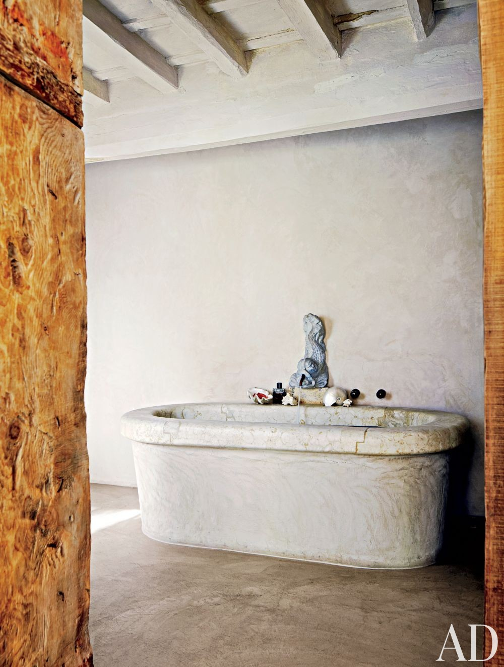 Rustic Bathroom by Axel Vervoordt and Alessio Lipari Architects and Serena Mignatti Architect in Rome, Italy