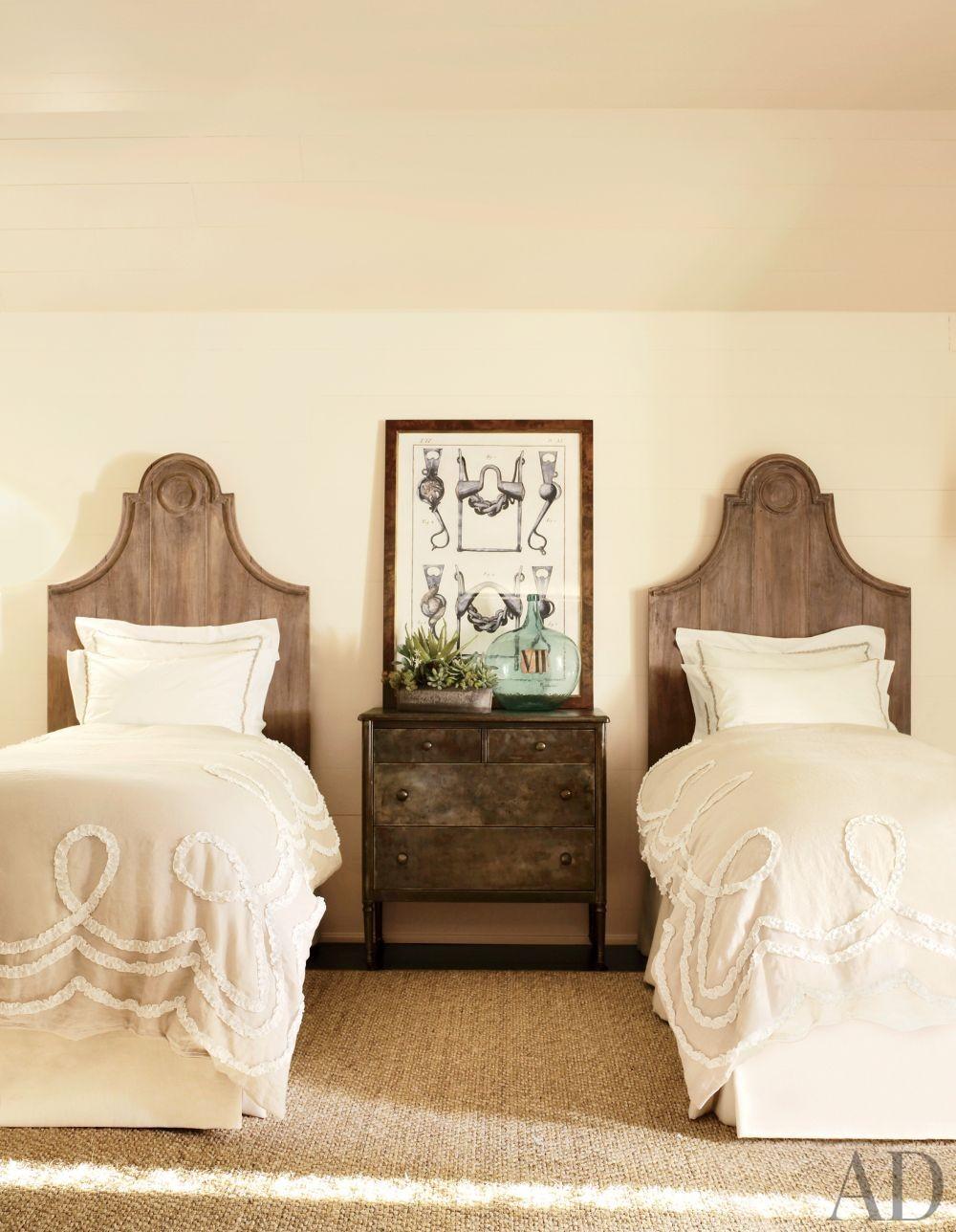 Rustic Bedroom by Suzanne Kasler Interiors and William T. Baker & Associates Ltd. in Atlanta, Georgia