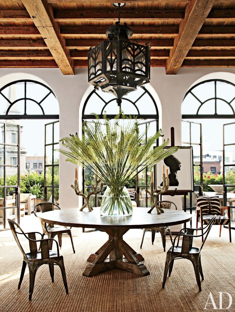 Rustic Dining Room by Alfredo Paredes and Michael Neumann Architecture in New York, New York