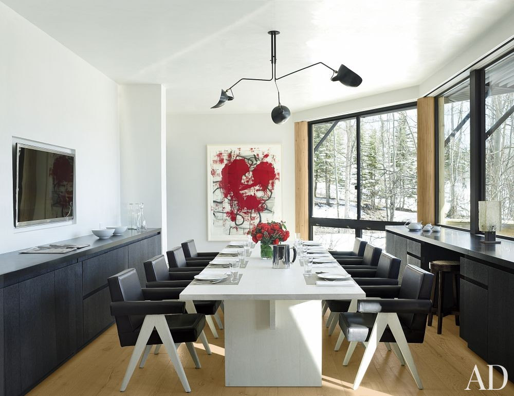 Rustic Dining Room by Atelier AM and Finholm Architects in Aspen, Colorado