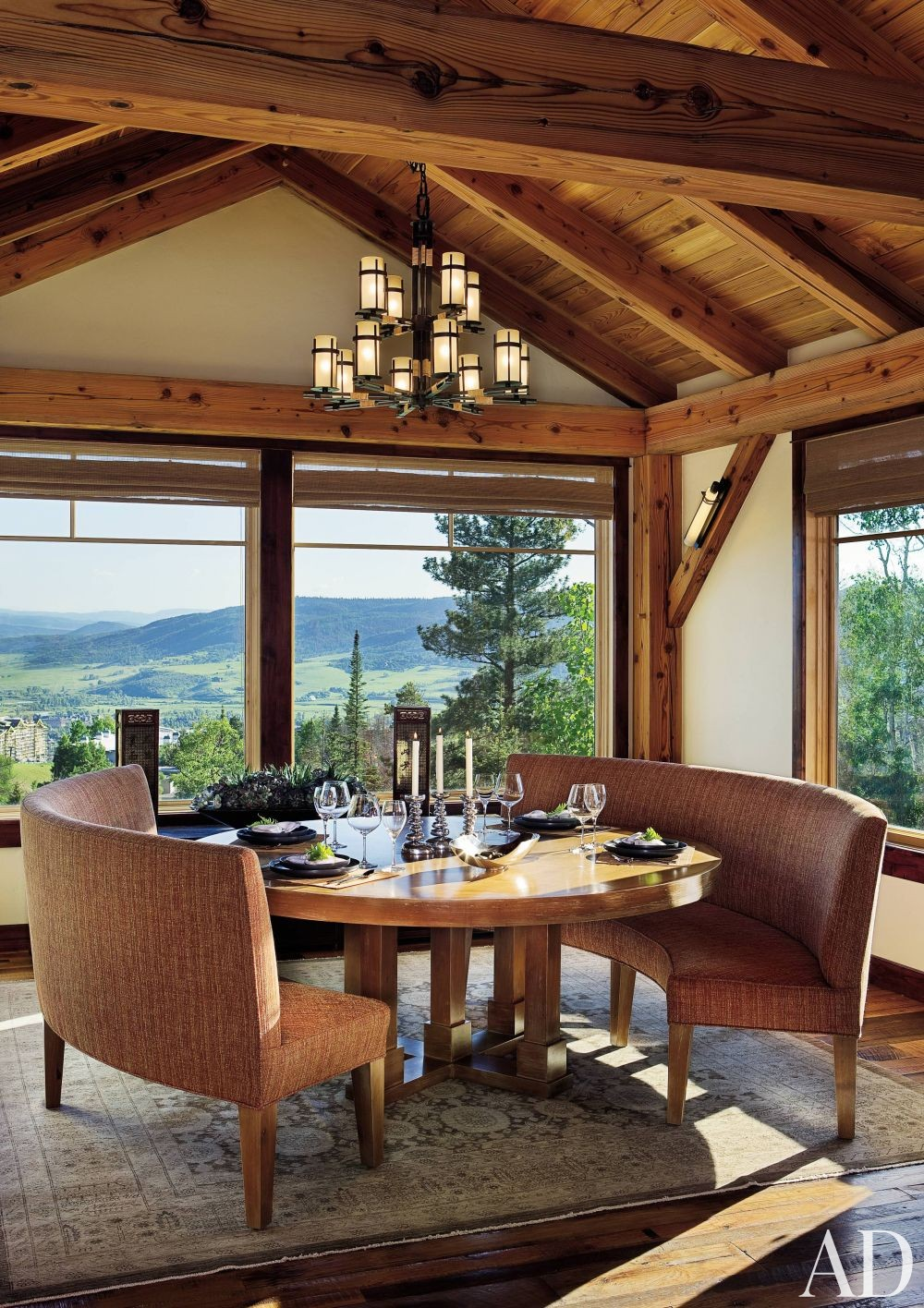Rustic Dining Room by Trilogy Partners in Steamboat Springs, Colorado