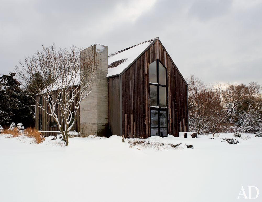 Rustic Exterior by D\'Apostrophe Design in Remsenburg, New York