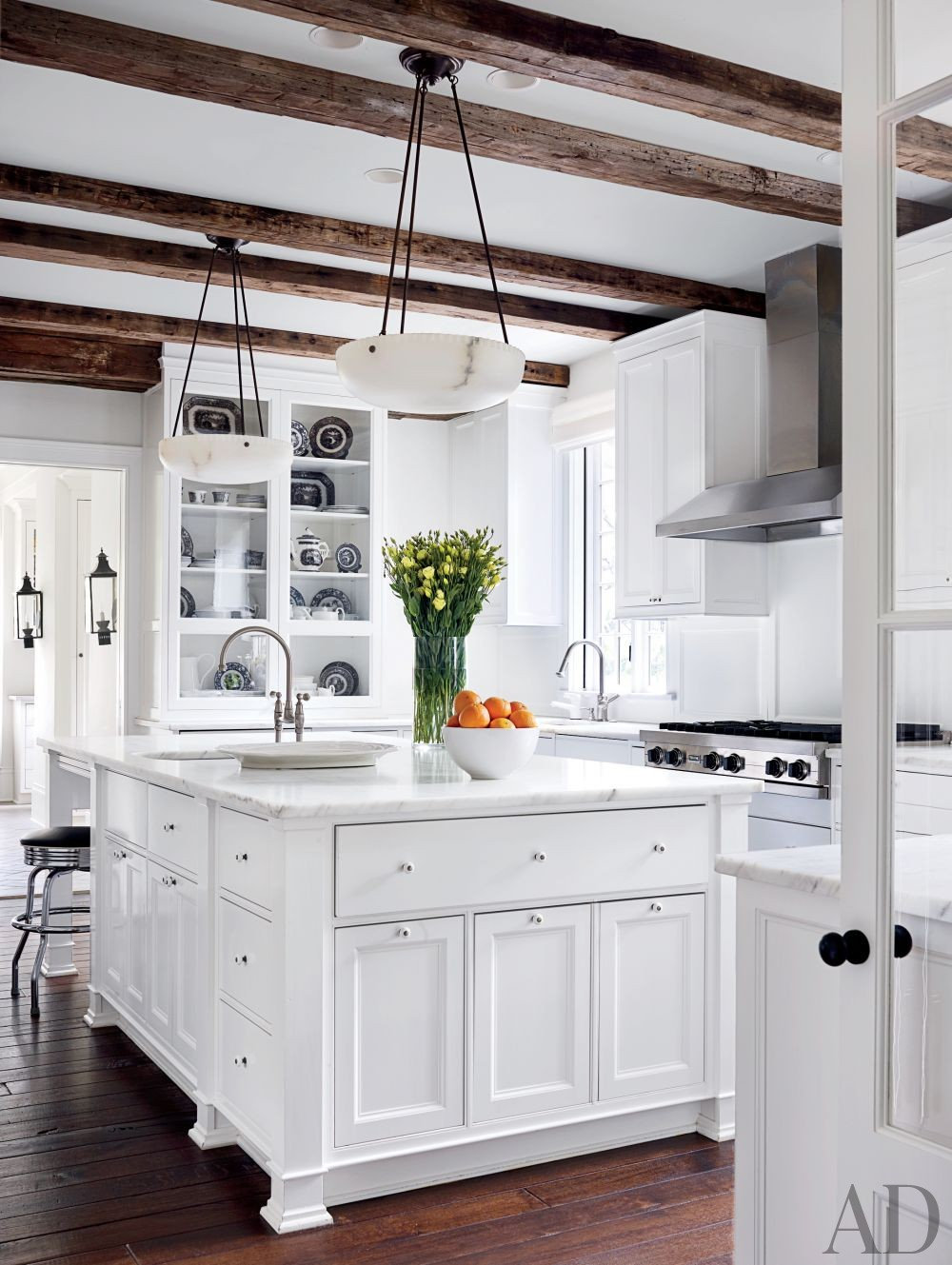 Rustic Kitchen by Darryl Carter Inc. and Donald Lococo Architects in Washington, D.C.