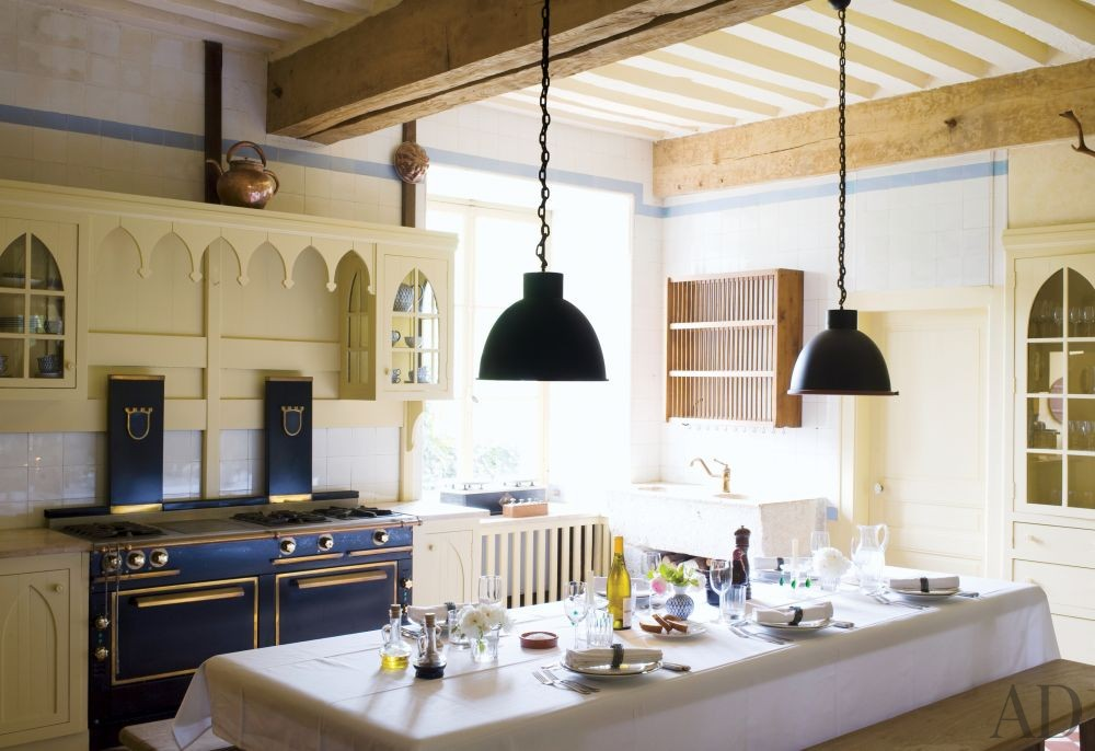 Rustic Kitchen by Mlinaric, Hernry & Zervudachi in La Beauce, France