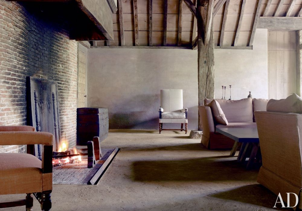 Rustic Living Room by Axel Vervoordt in Belgium