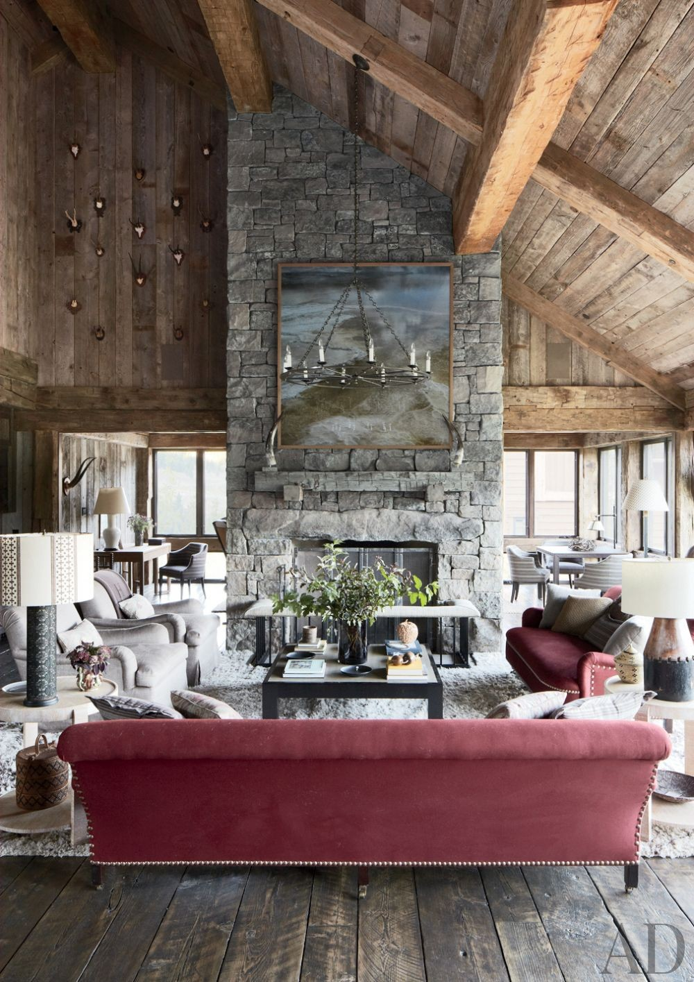 Rustic Living Room by Markham Roberts Inc. and JLF & Associates Inc. in Big Sky, Montana