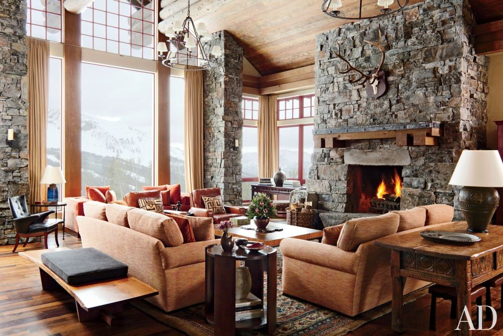 Rustic Living Room by Michael S. Smith Inc. and Locati Architects in Big Sky, Montana
