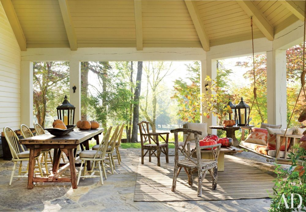 Rustic Living Room by Suzanne Kasler Interiors and Spitzmiller & Norris in Walland, Tennessee