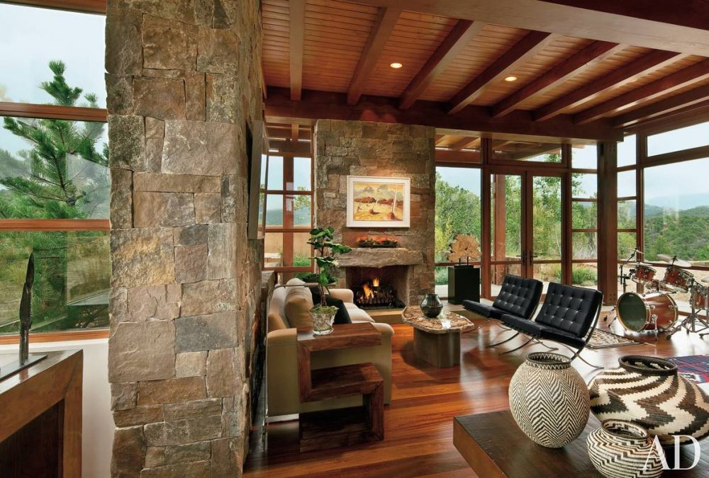 Rustic Living Room by Wilson Associates and Overland Partners Architects in Santa Fe, New Mexico
