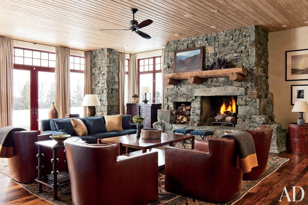 Rustic Media/Game Room by Michael S. Smith Inc. and Locati Architects in Big Sky, Montana