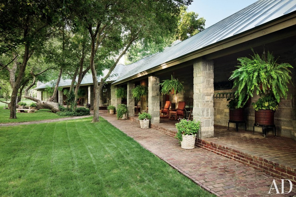 Rustic Outdoor Space by John Cottrell and Tommy Roberts in Texas