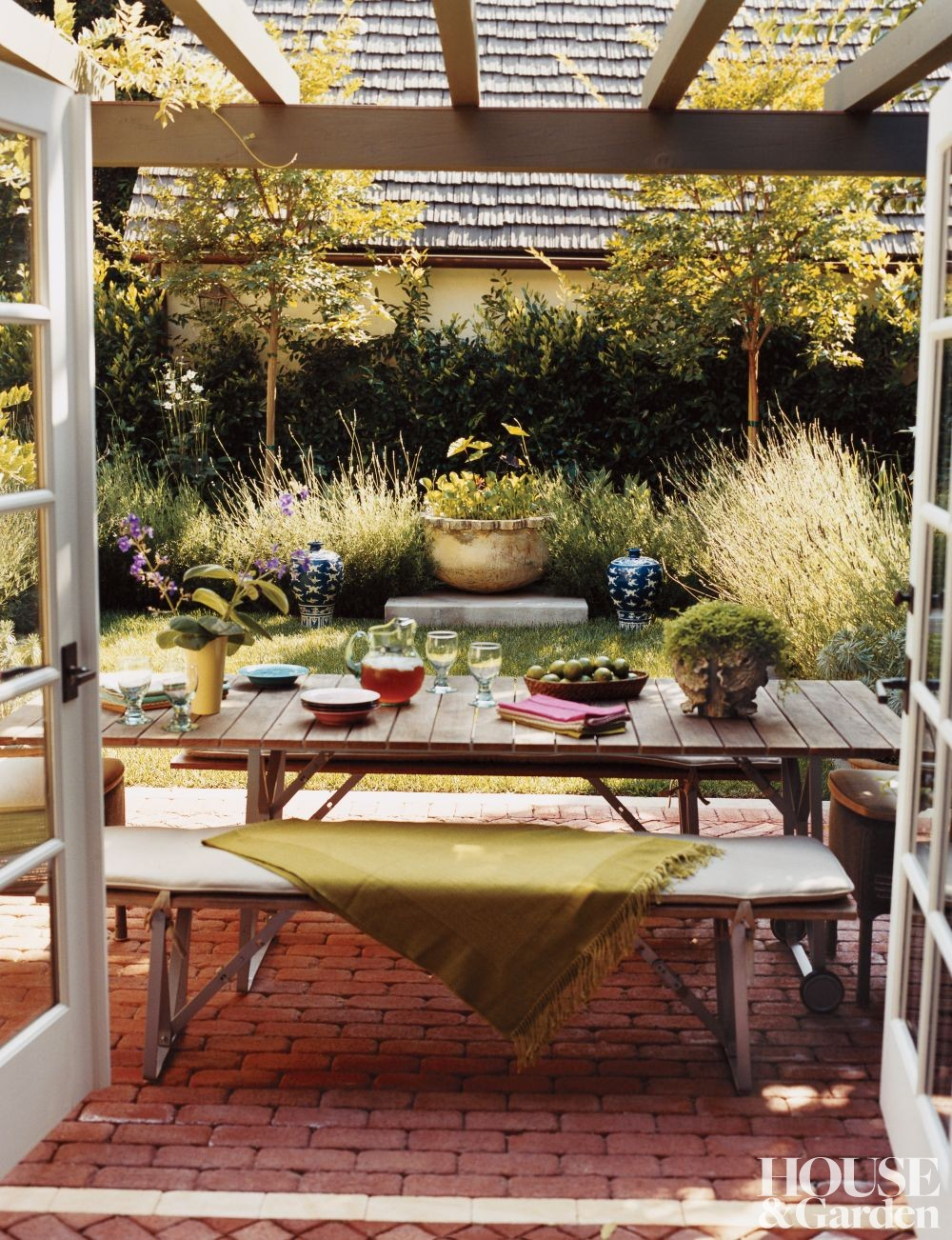 Rustic outdoor space by kim alexandriuk interior design by architectural digest ad designfile for Interior designer los angeles ca