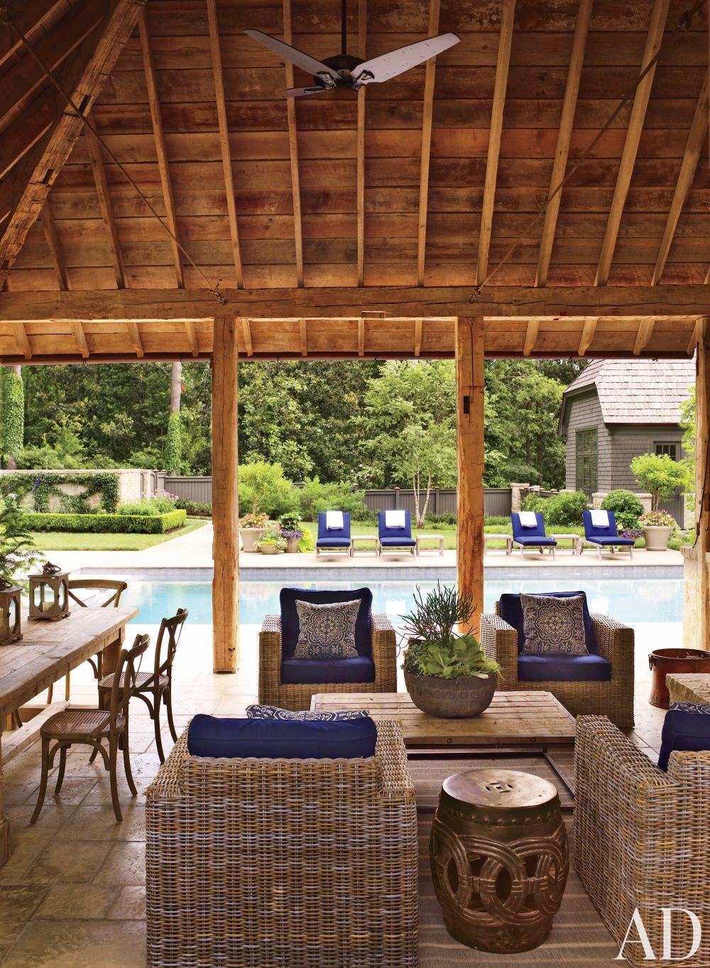 Rustic Outdoor Space by Suzanne Kasler Interiors and William T. Baker & Associates Ltd. in Atlanta, Georgia