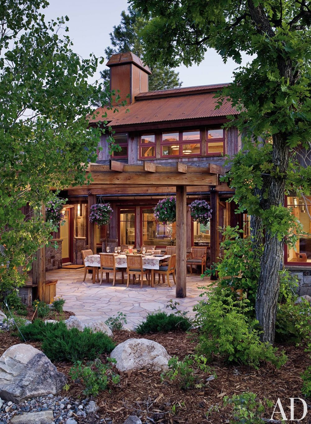 Rustic Outdoor Space by Trilogy Partners and Trilogy Partners in Steamboat Springs, Colorado