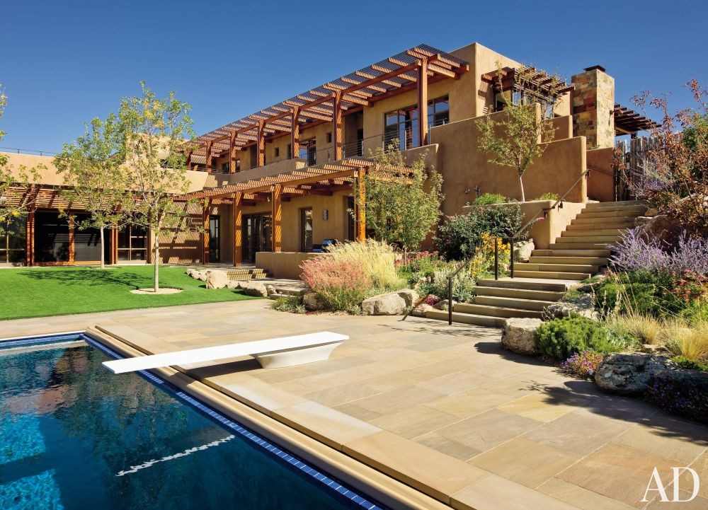 Rustic Pool by Wilson Associates and Overland Partners Architects in Santa Fe, New Mexico