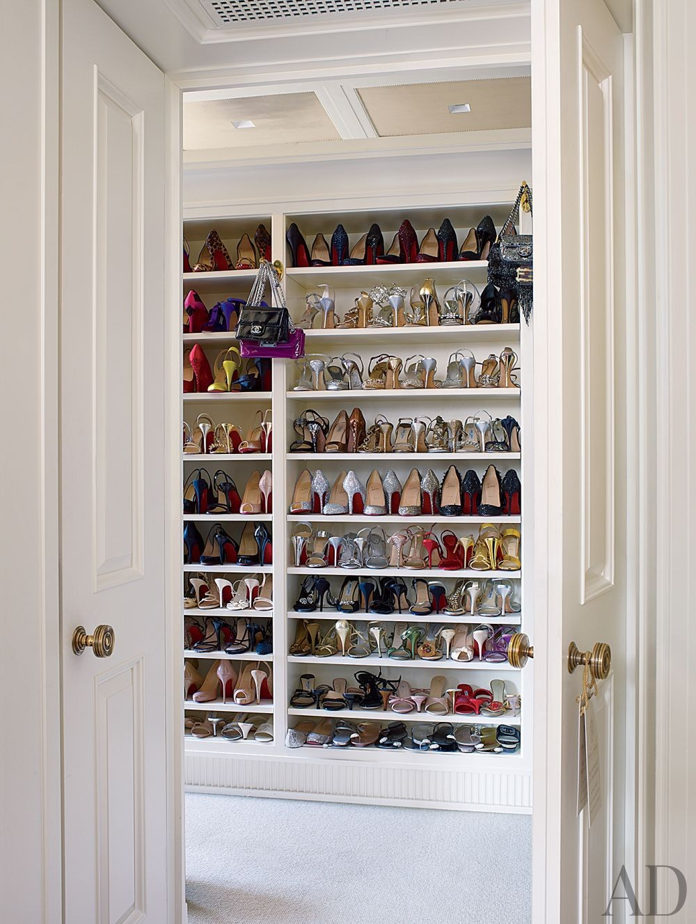 Traditional Dressing Room/Closet by Michael S. Smith Inc. and Peter Pennoyer Architects in New York, New York