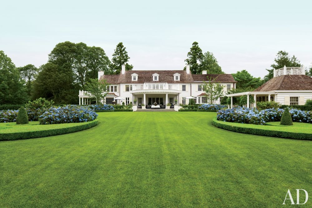 Traditional Exterior by Mario Buatta and Muse Architecture in Southampton, New York