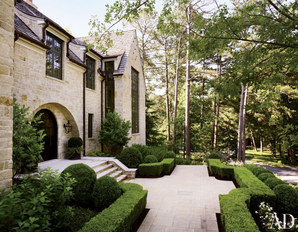 Traditional Exterior by Suzanne Kasler Interiors and William T. Baker & Associates Ltd. in Atlanta, Georgia