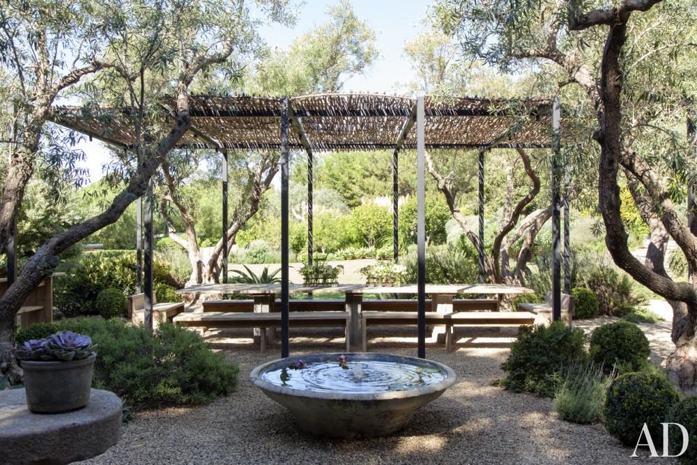 Traditional Outdoor Dining Area by Estee Stanley Interior Design in Malibu, California