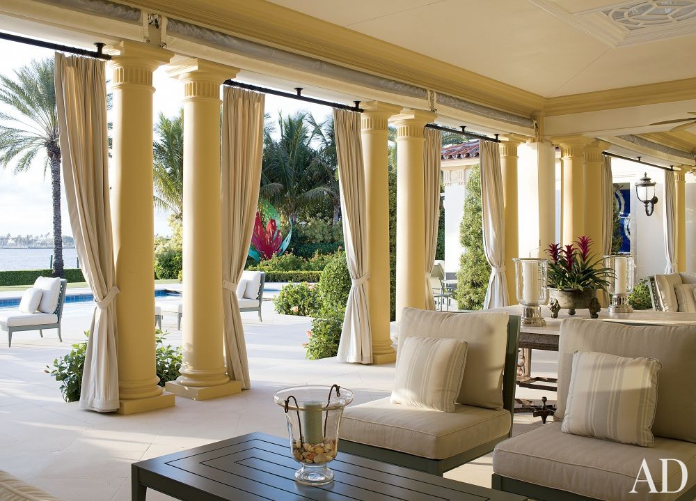 Traditional Outdoor Space by Aman & Carson in Palm Beach, Florida