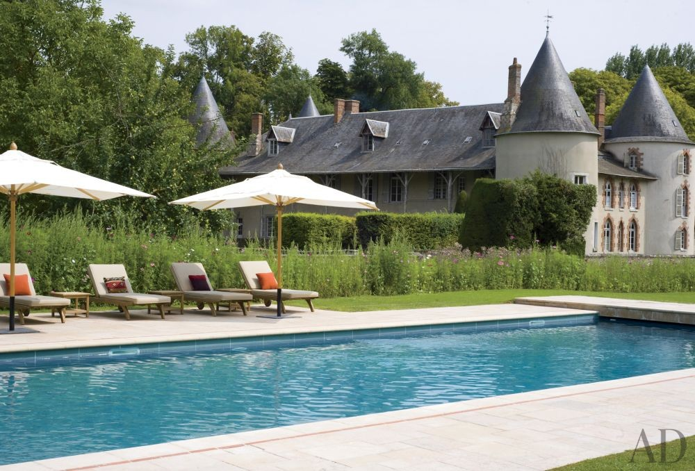 Traditional Pool by Mlinaric, Hernry & Zervudachi in La Beauce, France