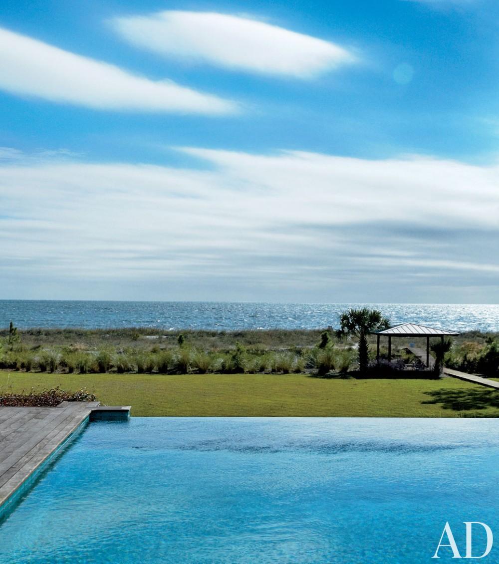 Traditional Pool by Monique Gibson Interior Design and Neil Gordon Architect in Daufuskie Island,South Carolina