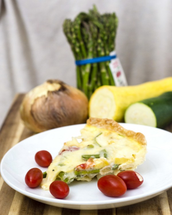 This veggie quiche is loaded with the freshest spring produce. It's a perfect make-ahead meal for breakfast, brunch or dinner! #WhatsBaking