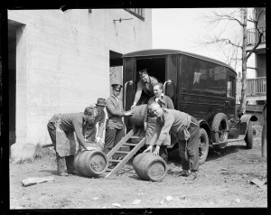 Police seizing illegal barrels of whiskey, courtesy Boston Public Library