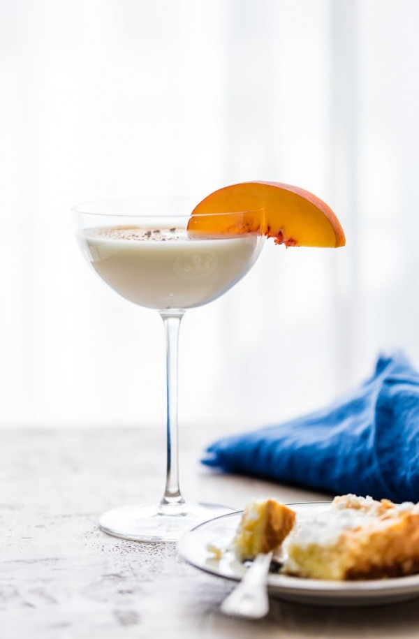 The GOOEY BUTTER CAKE MARTINI is a delicious way to drink your dessert! Decadent, indulgent, creamy goodness! Made with vodka, milk, white chocolate liqueur, frangelico, and butterscotch schnapps! YUM!