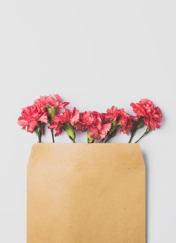 flowers in a brown letter bag