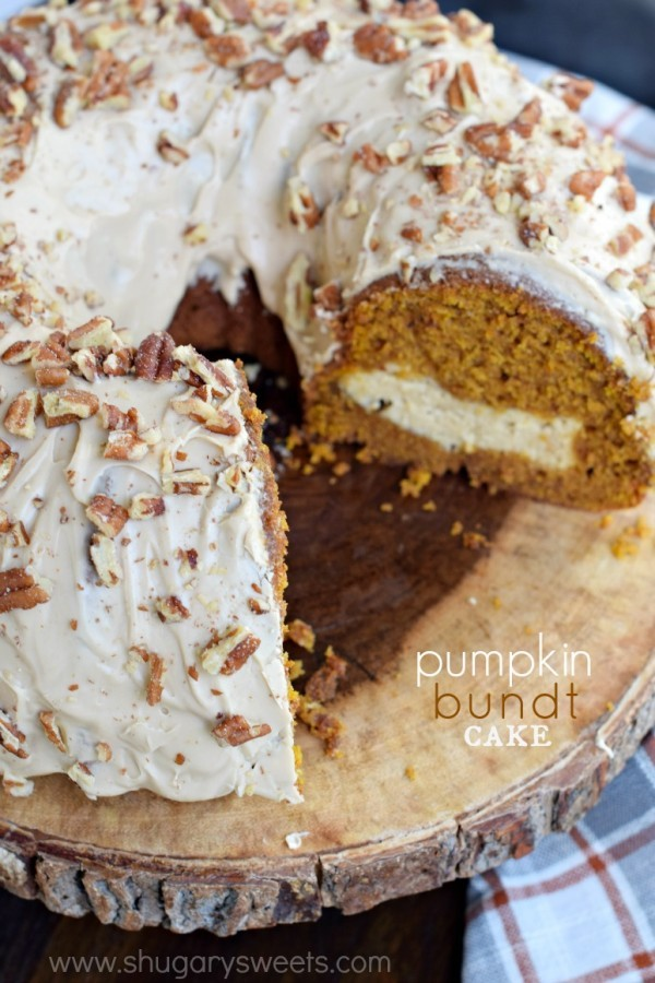 This stunning Pumpkin Bundt Cake recipe has a cheesecake filling and a maple pecan glaze! Fantastic flavor and easy to make too!