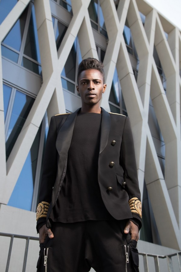 Introducing you Balmain x H&M men's collection + street style guide for Balmain x H&M men's collection written by jonthegold / photography by HOYmedia ( antwerp )  wearing black blazer with gold details and black pants with zips