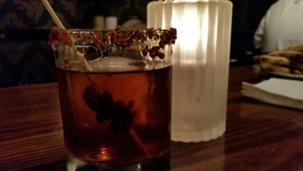 A bacon cocktail using the Hudson Maple Cask Rye Whiskey. From the Queen Vic Pub and Kitchen in Houston, TX